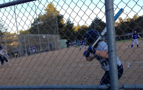 Abygail Lan watches Eimear Cunningham connect on a single to left field in the sixth inning.