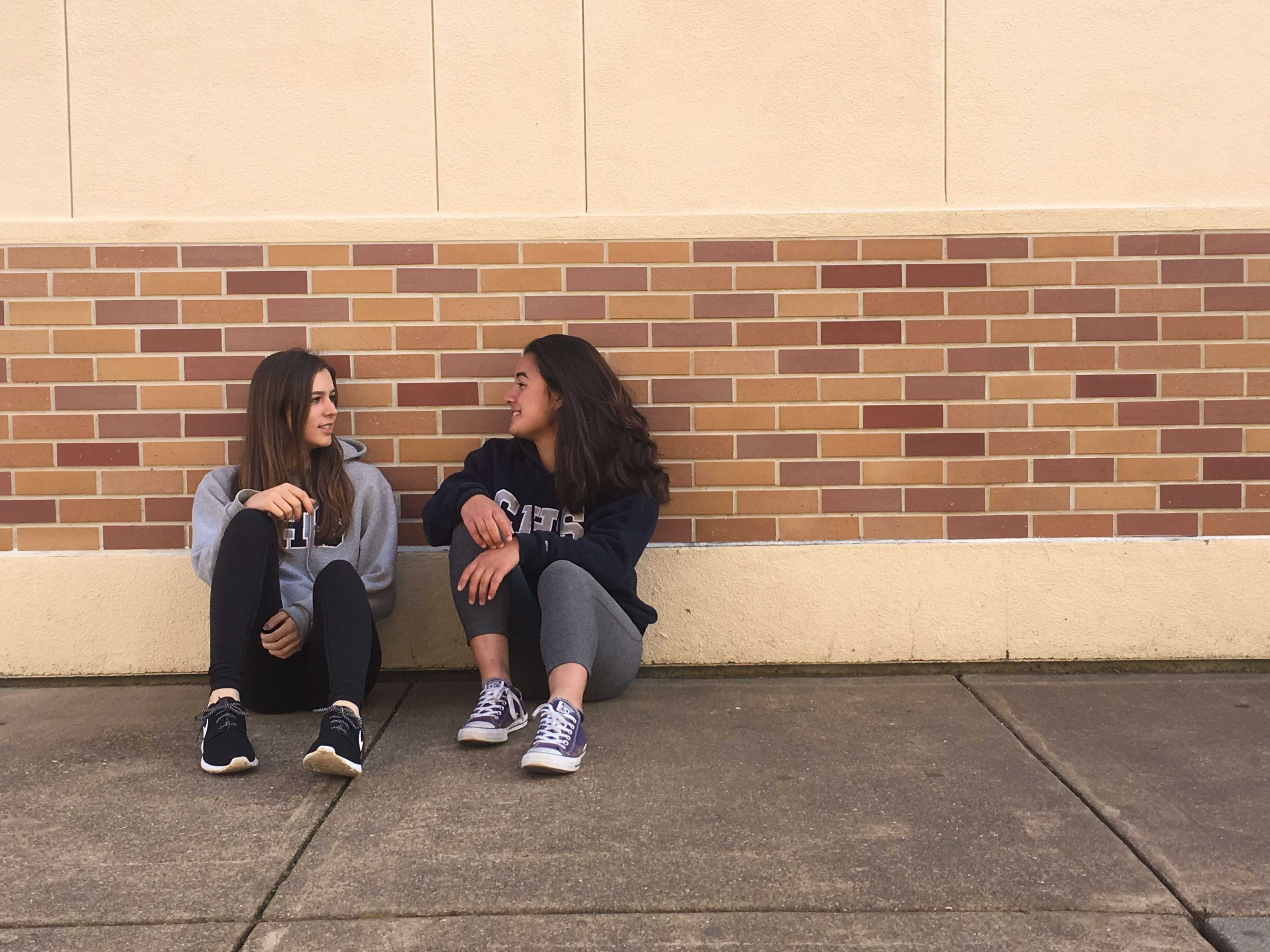 Sophomores Aimee Kanadjian and Sanni Karhiaho wear Carlmont sweathsirts. This is a common way that many students show their school spirit on a daily basis.