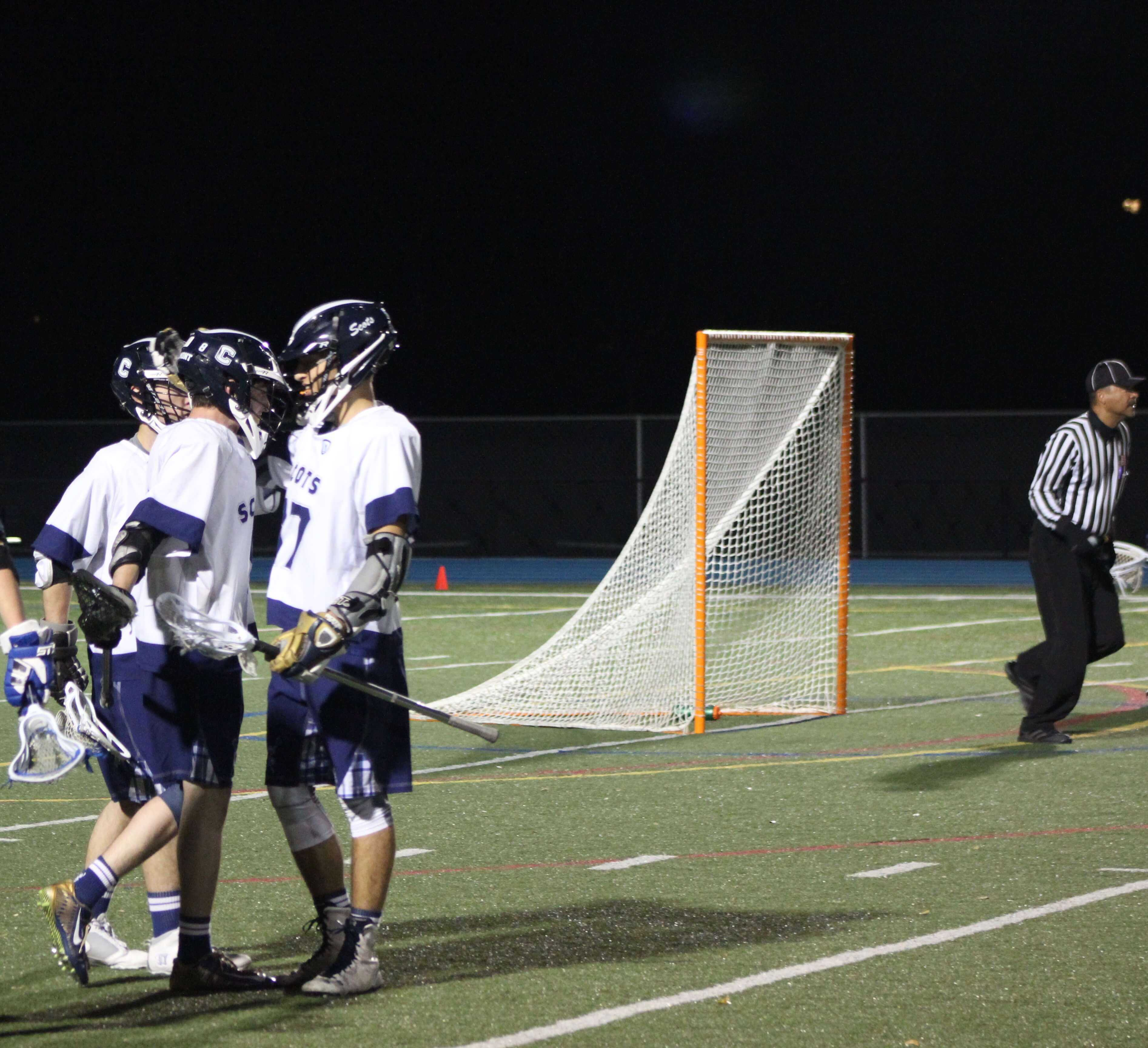 Jack Morris, a senior, gets congratulated by his teammates after his goal.