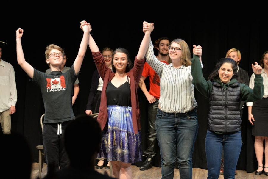 Salma Sebt, a junior, Elysia Wright, a junior, Amanda Masini, a junior, and Oliver Golden, a junior, from the cast of Space, written and directed by Megan Wadleigh, a senior, stand for a bow at the end of the show. (Photo credit: Robyn Peters)