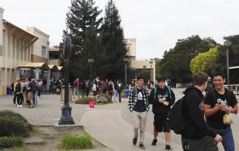Students enjoy the clean campus as they stroll through the quad to throw away their food.