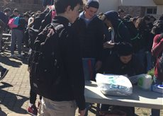 Students fill the quad as the clubs start selling food at the Heritage Fair.