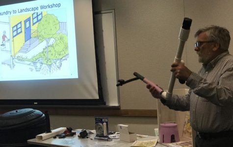 Tom Bressan, president of The Urban Farmer Store, demonstrates how to use a rainwater pipe for the audience.