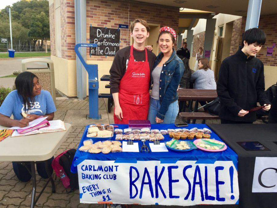 Sophomores Will Nadan and Jade Margolis sell a variety of baked goods to fundraise for their club at Open House.