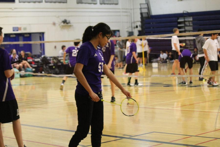 Sequoia player ______ lines up her serve against her Carlmont opponent.