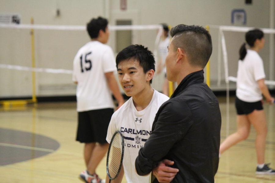 Sophomore Alexander Wang talks to coach Nathan Liang during Wang's singles match