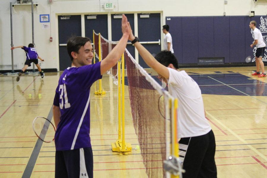 Sophomore Alexander Wang and Sequoia junior Duncan Stewart high five at the end of their singles match.