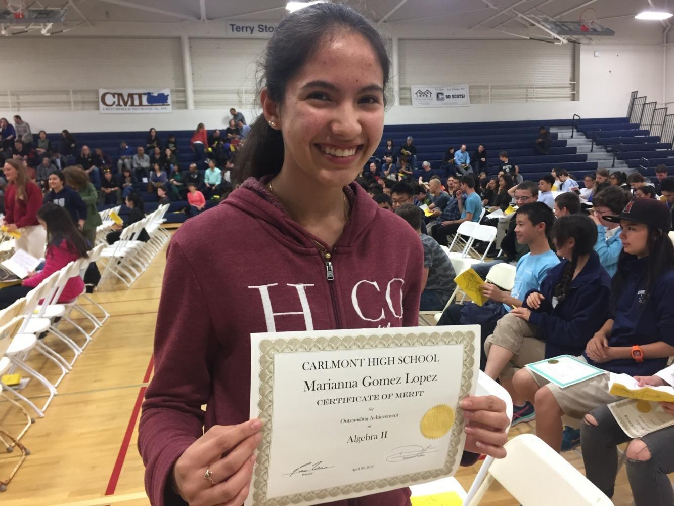 Sophomore Marianna Gomez Lopez holds up her Algebra 2 award.