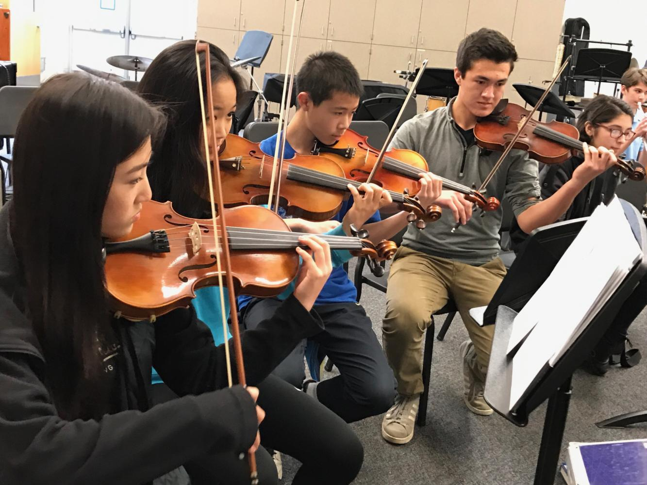 Freshmen Denise Zhou, Selena Sun, and Vernon Luk practice their part in
