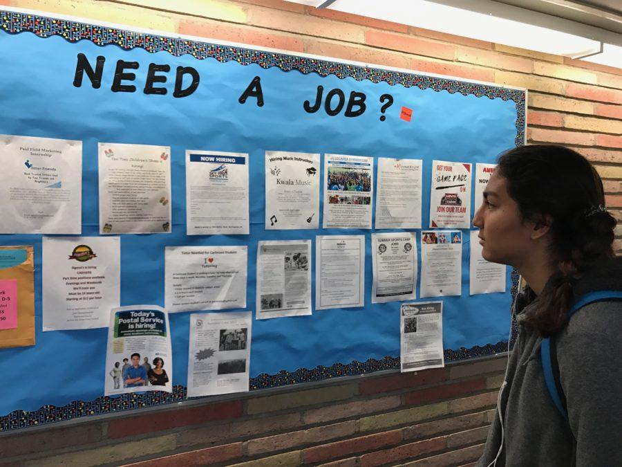 Sophomore+Seema+Wadhwa+looks+at+the+B-hall+bulletin+board+before+class.+Wadhwa+hopes+to+find+an+interesting+job+opportunity.