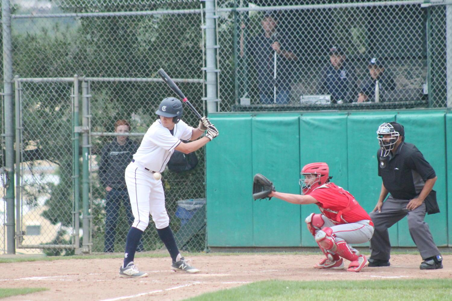 Sophomore David Bedrosian avoids a pitch and gets a walk during the game against Burlingame.