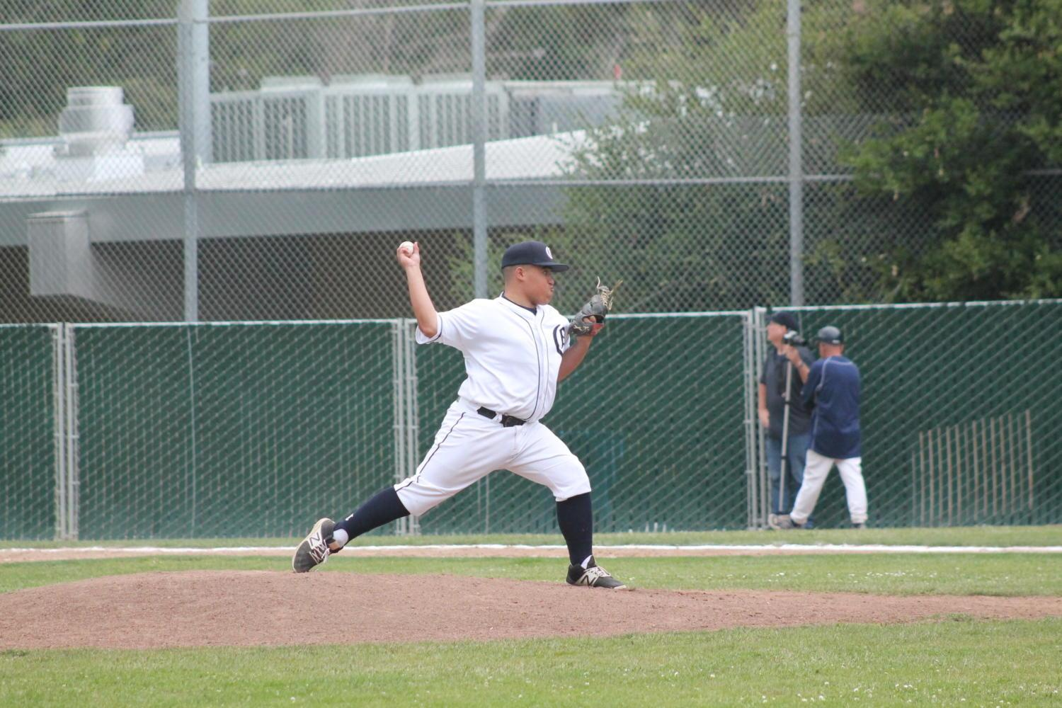 Freshman Tyler Flores closes out the game pitching against Burlingame for the sixth and seventh innings.