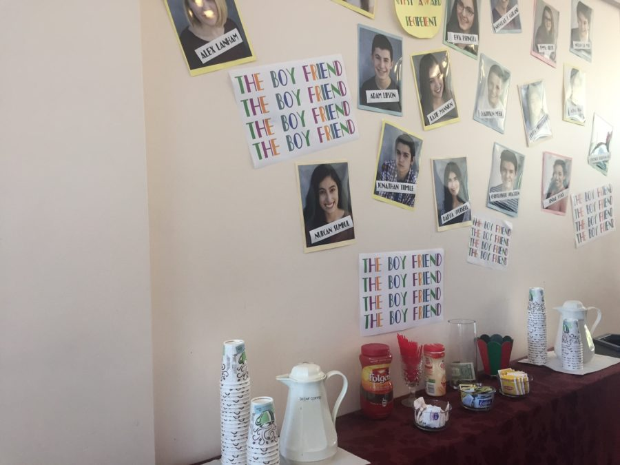 The theatre posted the casts picture on the wall for the viewers to see.
