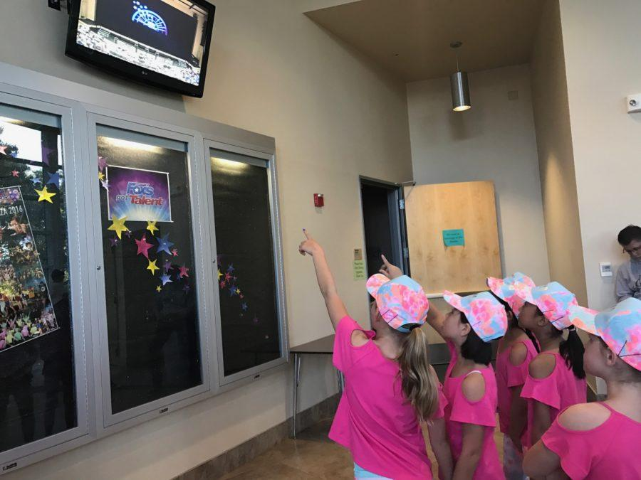 Girls from the third-grade girls act get hyped up for the show.