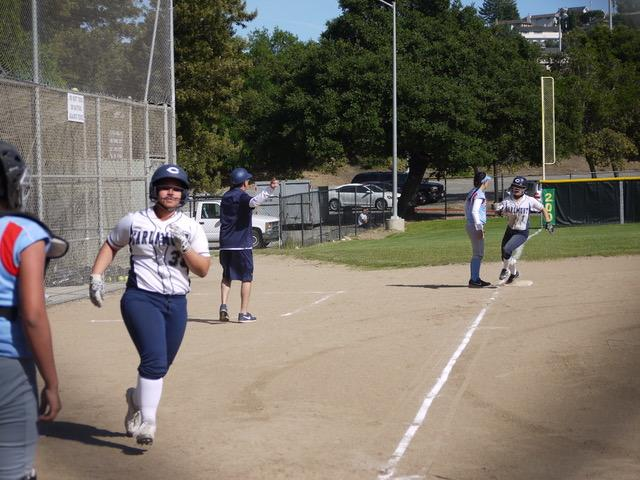 Mia Rosas, a freshman runs home after the ball was hit into the outfield, earning the Scots another run.