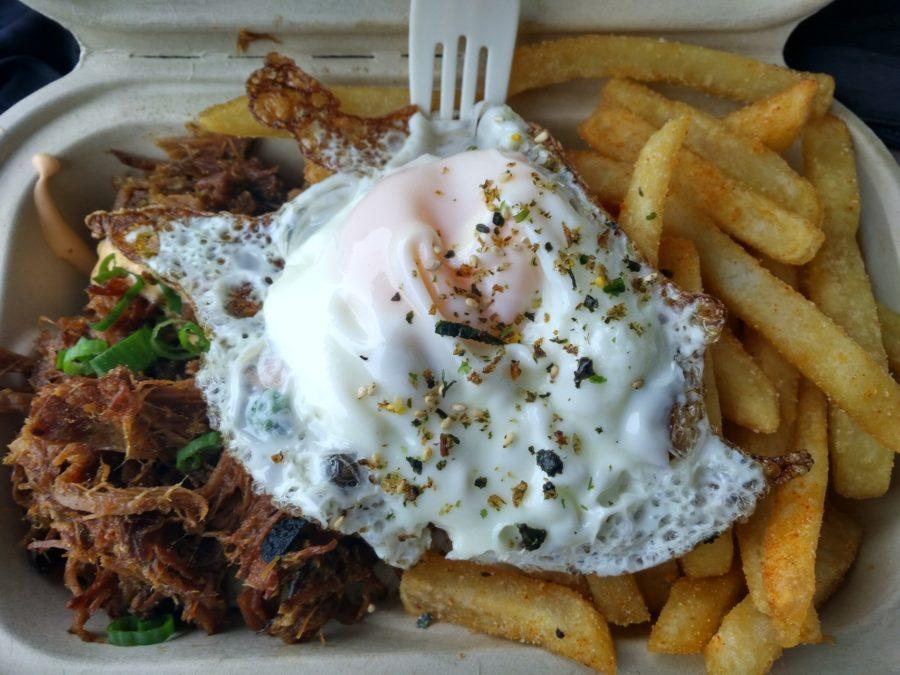 A+meal+consisting+of+spiced++pulled+pork%2C+a+fried+egg%2C+white+rice%2C+and+french+fries++tastes+really+good.