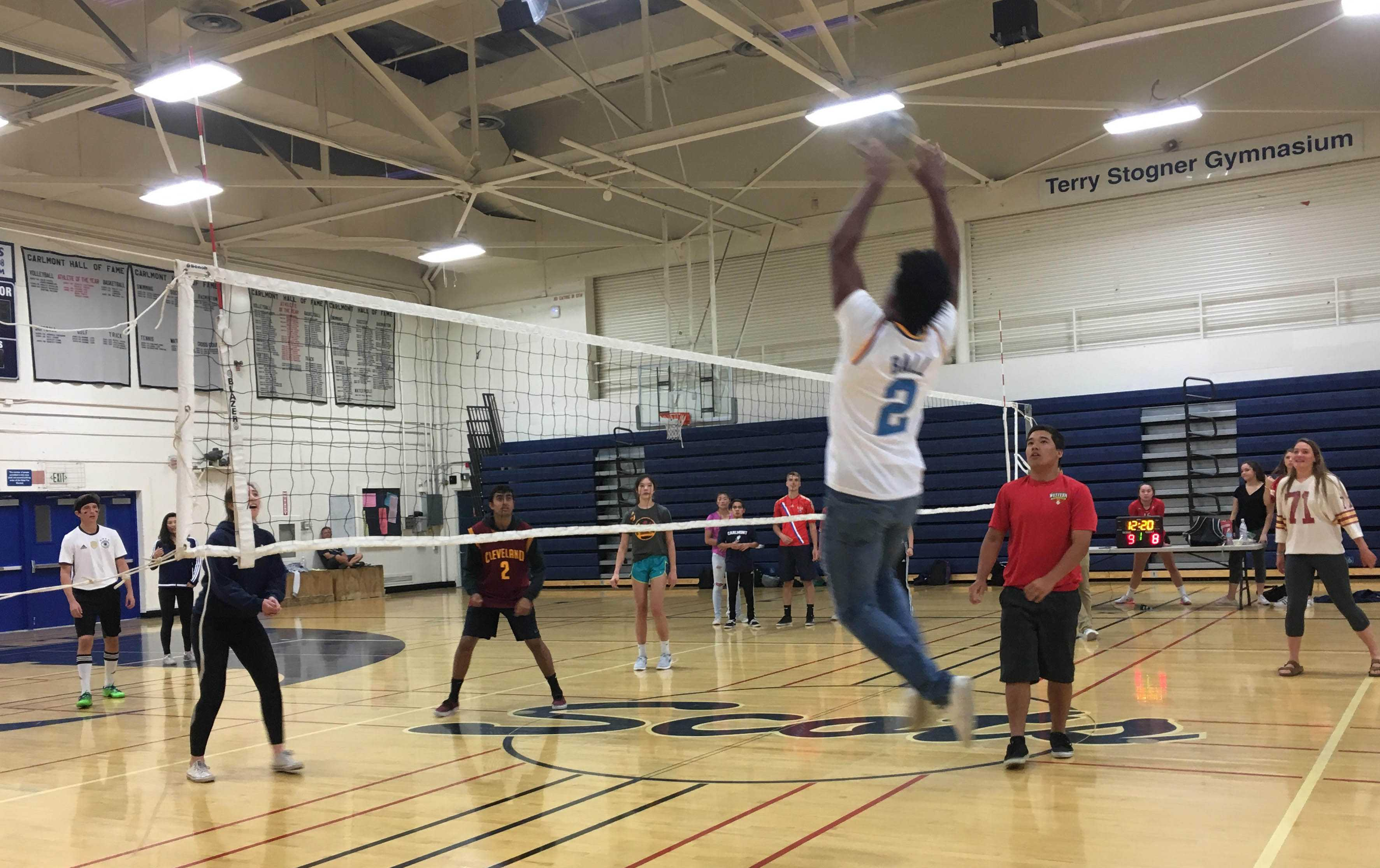 Demarii Blanks, a junior, goes to set the ball to his teammates to spike for a point.