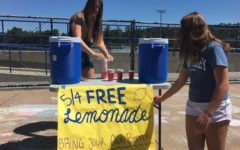 Liz Boman, a member of the ASB do something commission sets up for the lemonade stand at lunch.