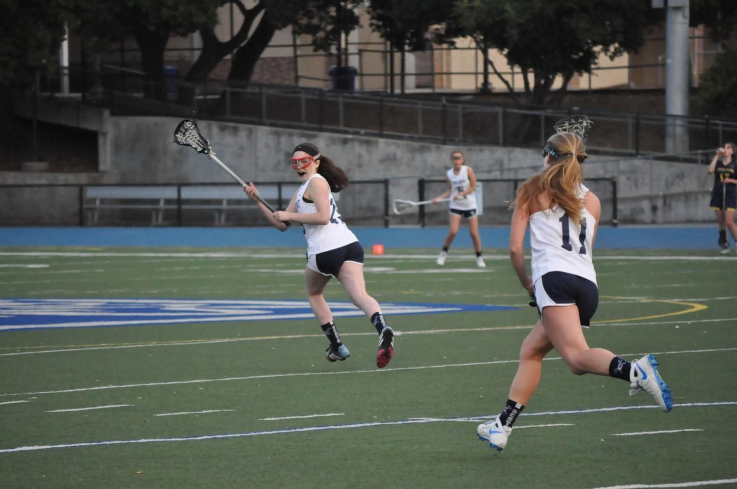 Lillian Diesh, a junior, runs downfield awaiting the pass from Caroline Concilla, a senior.