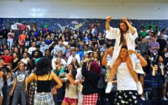 The 2016 Celebration Assembly brought many students together to celebrate their past year at Carlmont. Class of 2016 graduate, Erin Alonso, hops on the shoulders of her friend and current junior, Jason Lloyd, to celebrate her last year at Carlmont.