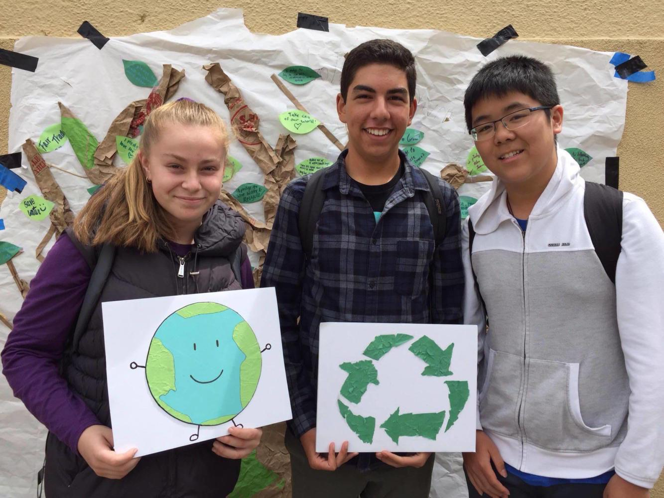 Students posed with the Pledge Tree to show their commitment to their environmental pledges. Some pledges included using reusable water bottles, composting, carpooling, and spreading the word about being eco-conscious.