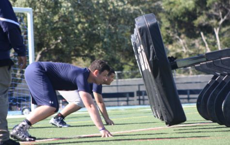 Varsity football players practice lineman drills after school on May 25.
