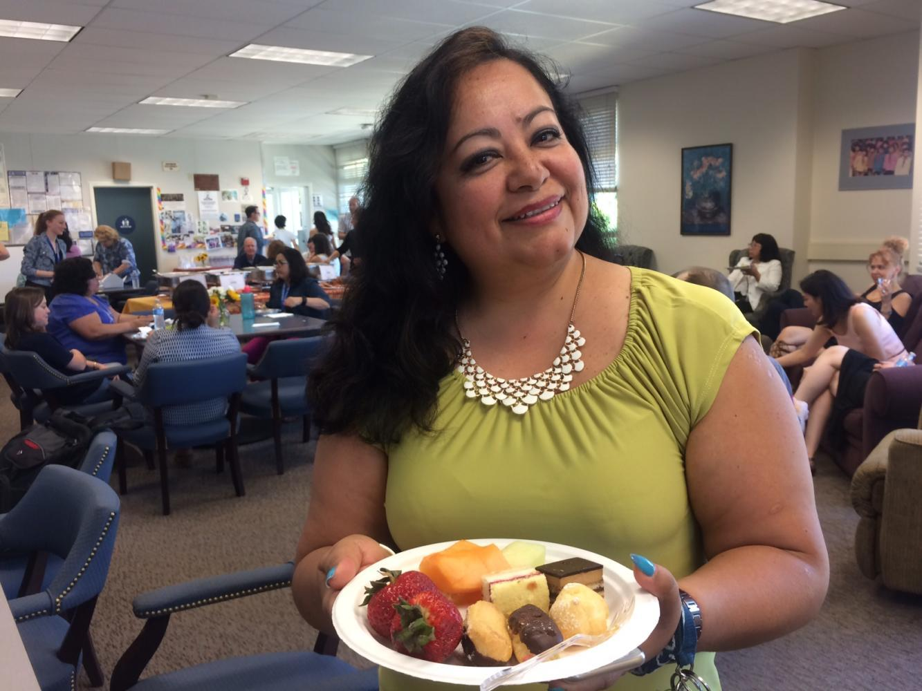 Rosa Argaluza, a Spanish teacher, gets food in the Teachers' Lounge during the Vivace Luncheon for Teacher Appreciation Week.