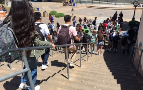 Students head down the quad stairs at the beginning of lunch to receive their free copies of