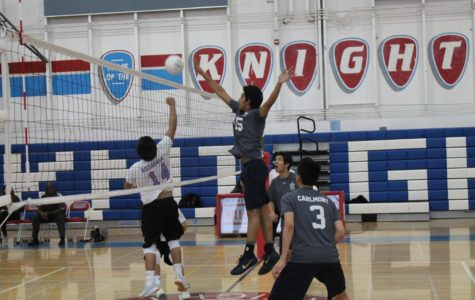 Kazmin Haider, a junior, hits the ball over the net to the Knights.