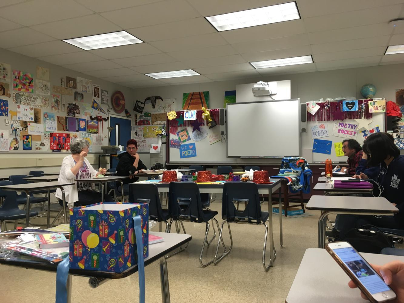 Members of Creative reWriters gather to discuss future plans in the colorful room of Mrs. Wallace.