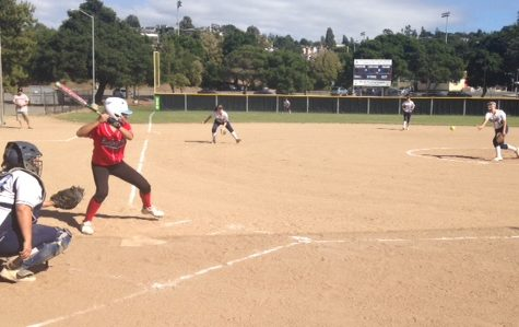 Freshman Alisilani Alusa pitches to sophomore catcher Grace Heck.