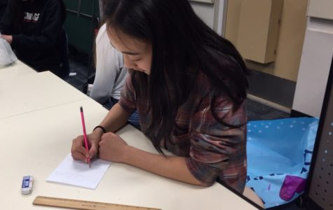 Sophomore Rachel Gu designs a flyer to inform the student body of events around school.