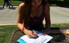 Maya Schwartz, a junior, signs up the girls tennis team for Carlmont Cup.