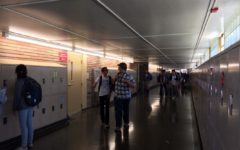 Students walk to class after lunch. Most students walk in groups as to not look
