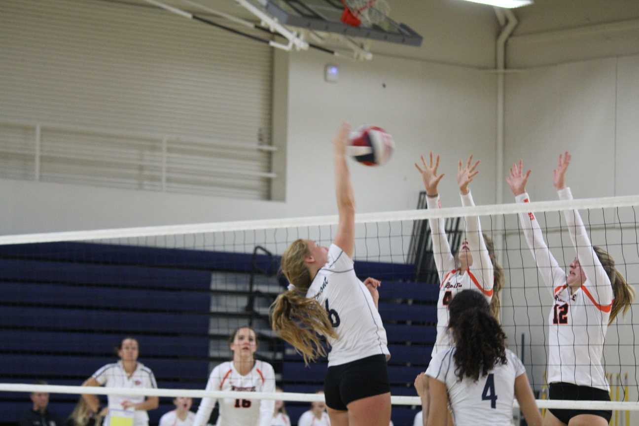 Vanoncini spikes the ball over the net, earning a point for the Scots.