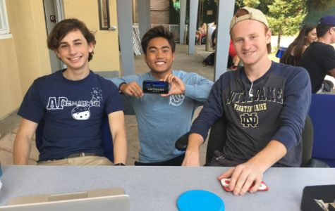 Seniors Edward Vendrow, Josh Camerino, and Brock Lotti sit at the senior sweatshirt sales table during lunch.