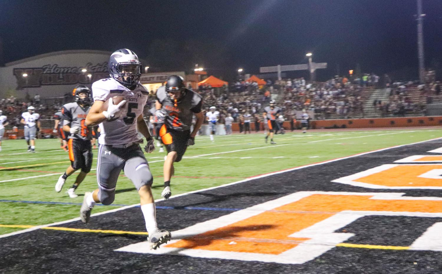 Varsity football emerges victorious against the Woodside Wildcats
