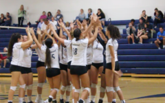 Varsity volleyball wins a hard-fought victory over the Bearcats