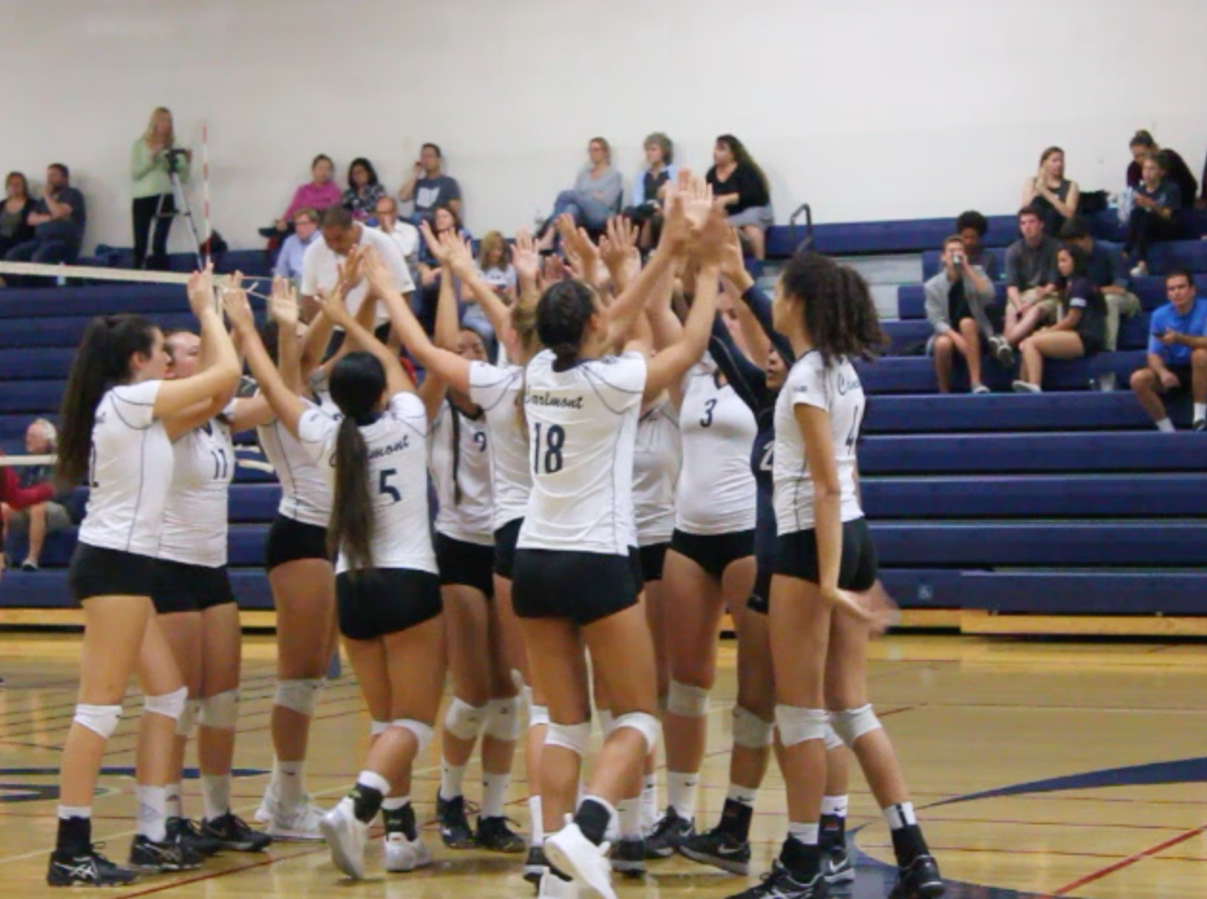 Scots cheer after winning the point in a long rally against the San Mateo Bearcats.