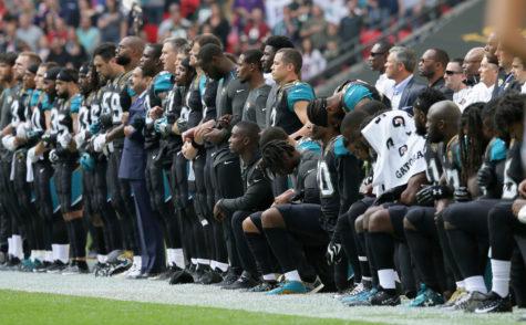 We stand united, we kneel divided