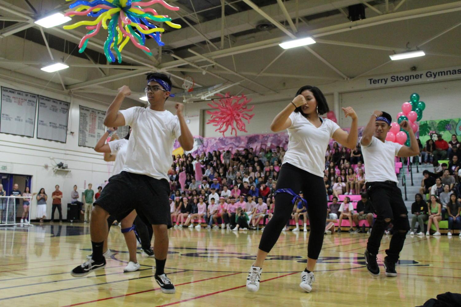 Hip hop club hypes up the audience during their performance
