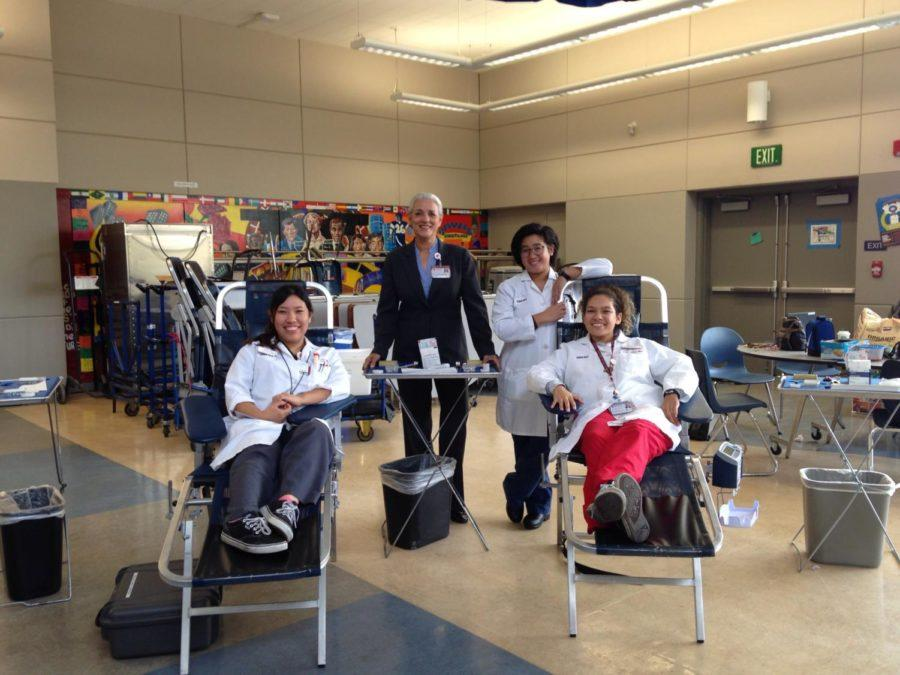 Stanford Blood Center staff smile for the camera.