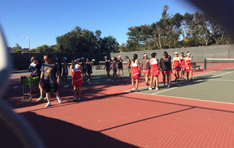 The varsity girls' tennis team prepares to play against the El Camino Colts in a PAL tournament game.