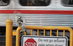 Flowers lay at the Whipple Avenue railroad crossing in Redwood City in memory of Sequoia High School freshman Holly Spalletta.