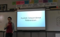 Sam Hosmer, a junior, lectures on the issue of the Kurdish Independence Referendum.