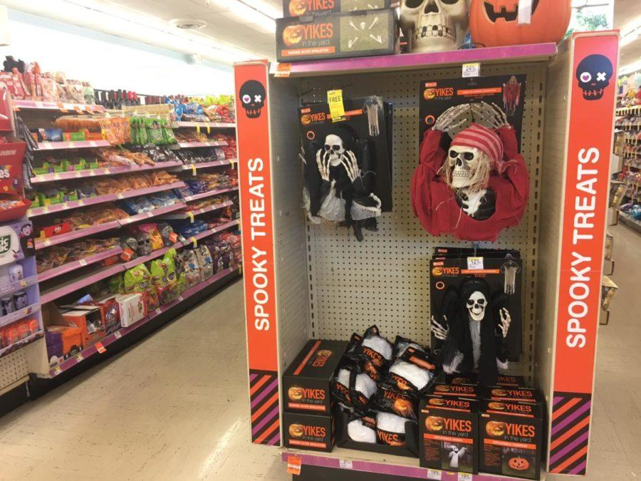 Local businesses try to attract customers with Halloween items.