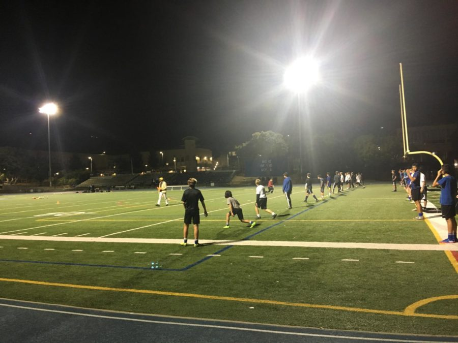 Carlmont boys stretch during soccer tryouts on Oct. 31.