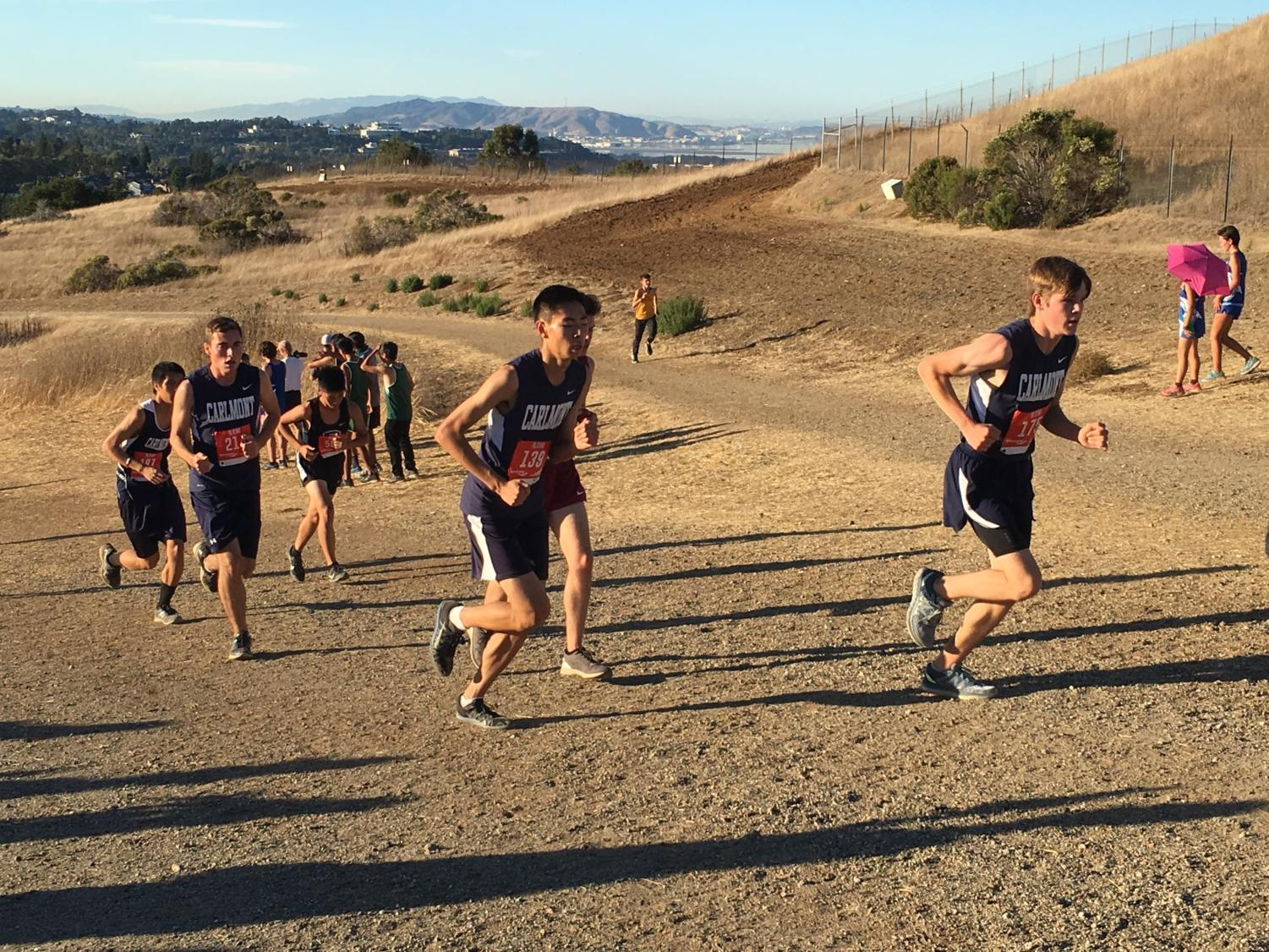 Caleb Ahn and Sam Holbrook, both juniors, make their way up the first hill at the Crystal Springs Course.