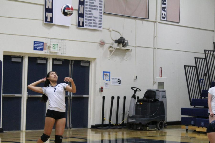 Sophomore Kristen Leong gets ready to serve.