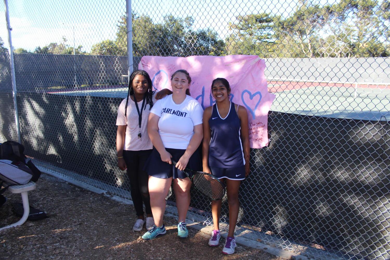 Sandra+Strongin+%28center%29%2C+a+senior%2C+celebrates+her+final+home+match+with+the+girls%27+varsity+tennis+team+on+Oct.+23.